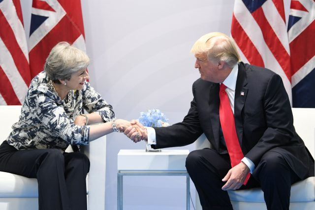 Theresa May talks to Donald Trump. (Stefan Rousseau/PA)