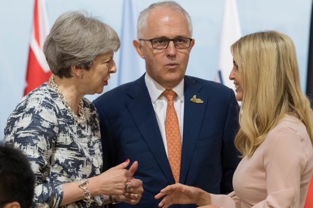 Theresa May meets Australian Prime Minister Malcolm Turnbull and Ivanka Trump (Stefan Rousseau/PA)