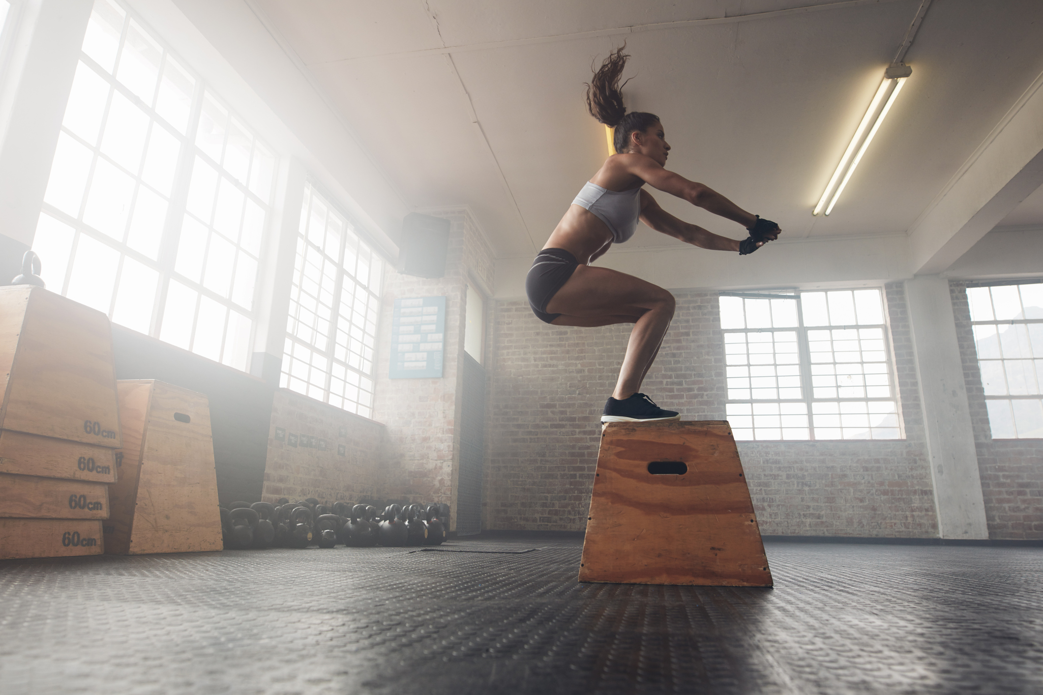 Generic photo of woman doing a box jump in a gym (ThinkStock/PA)