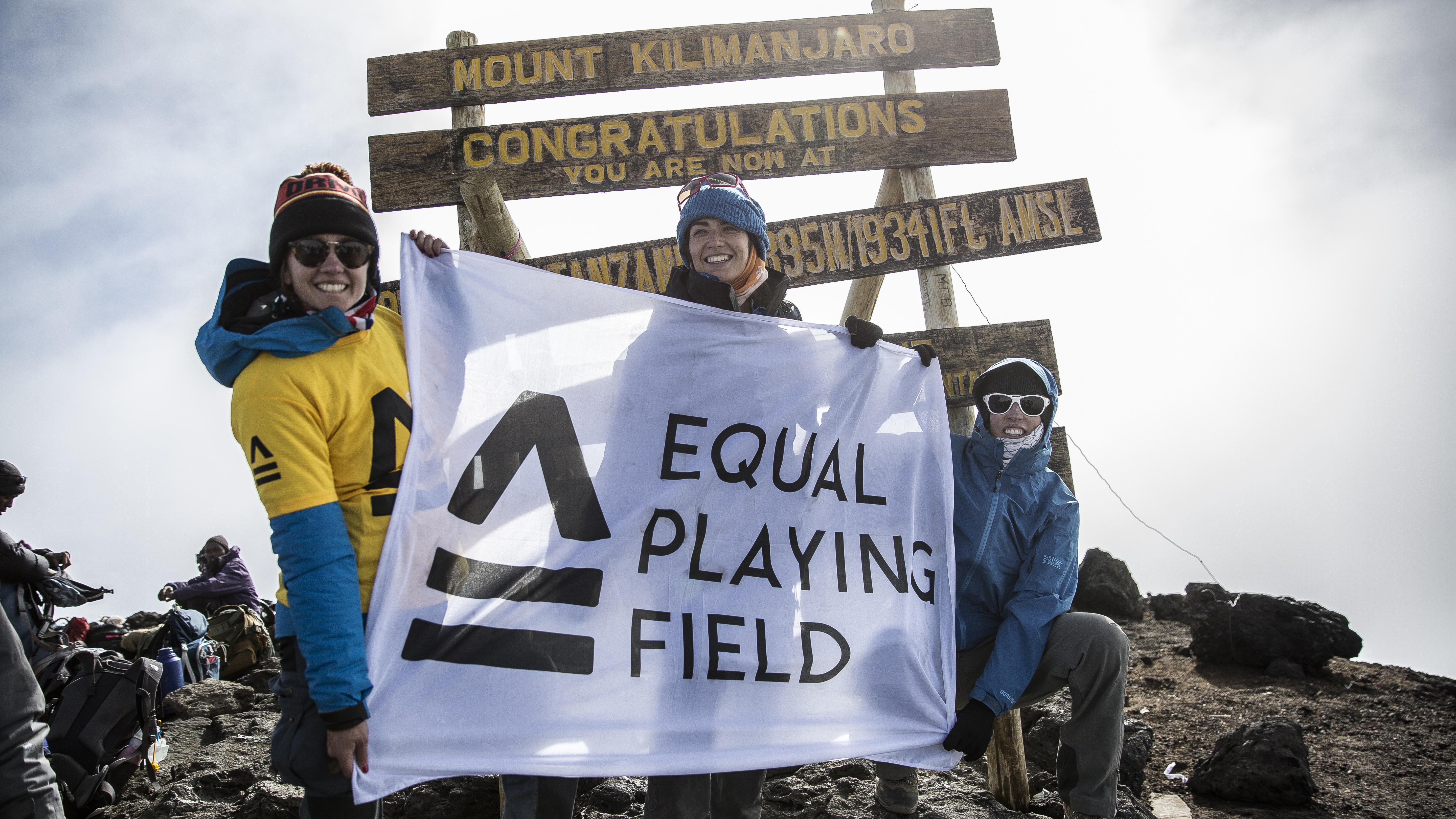 Three players at Kilimanjaro summit after Equal Playing Field's record-breaking football match in Kilimanjaro crater (Dana Roesiger/EPF/PA)
