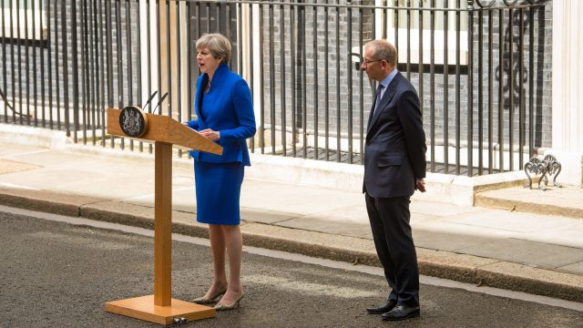 Theresa May addresses the media the day after the general election with husband Philip by her side