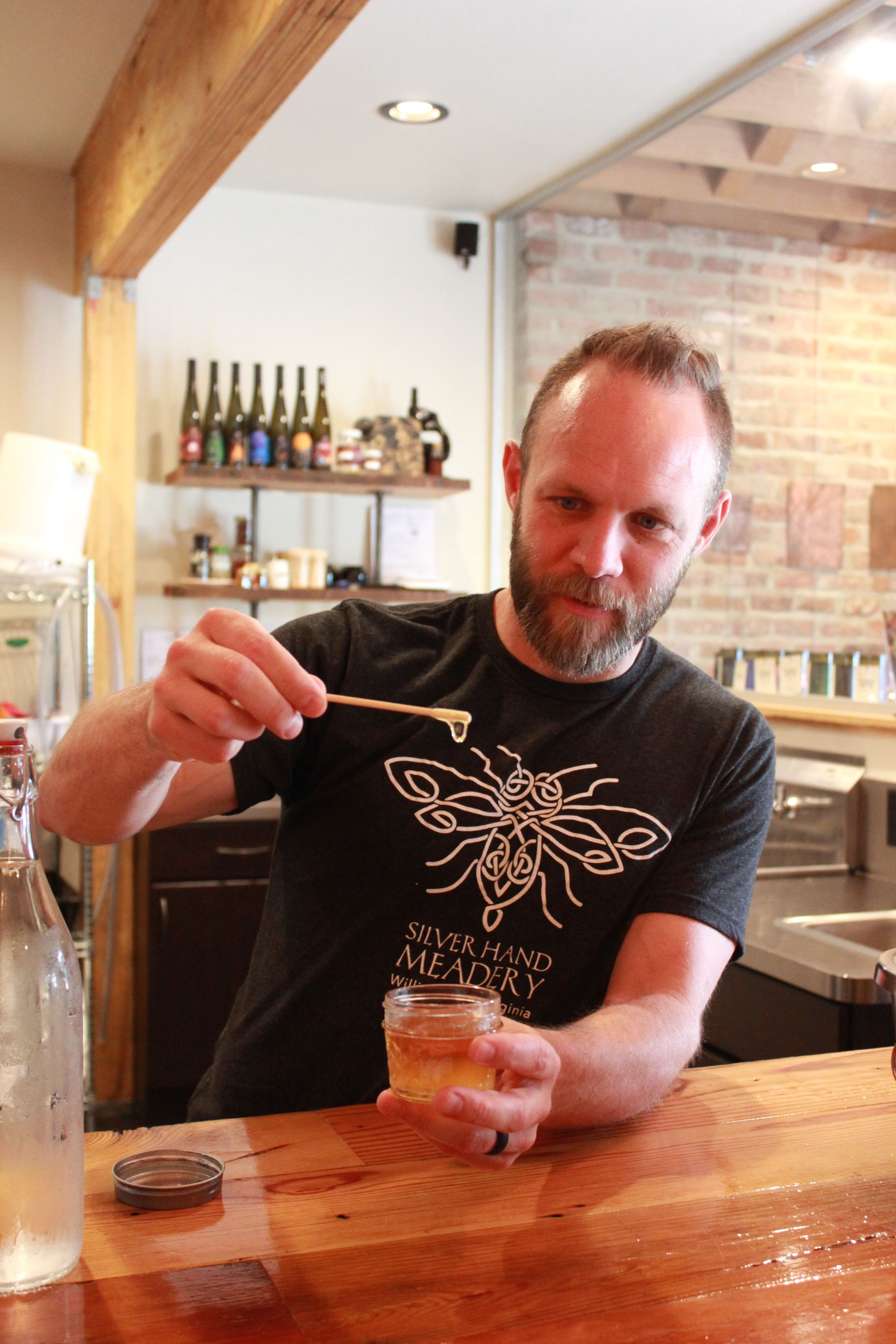 Glenn Lavender hands out sampes of honey at the Silver Hand Meadery in Virginia