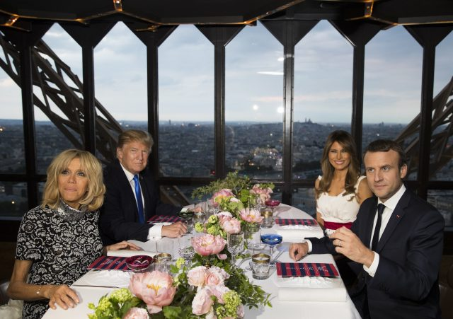 The presidents and their wives sit for dinner in the Eiffel Tower
