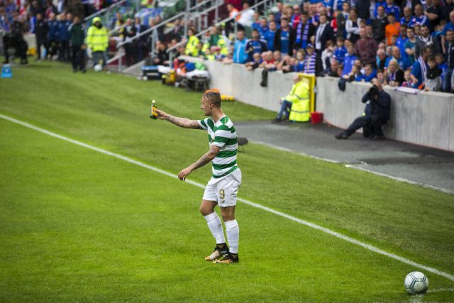 Celtic striker Leigh Griffiths shows the referee an empty bottle of Buckfast after it was thrown at him as he attempted to take a corner kick during the UEFA Champions League Qualifying, Second Round, First Leg match at Windsor Park, Belfast.