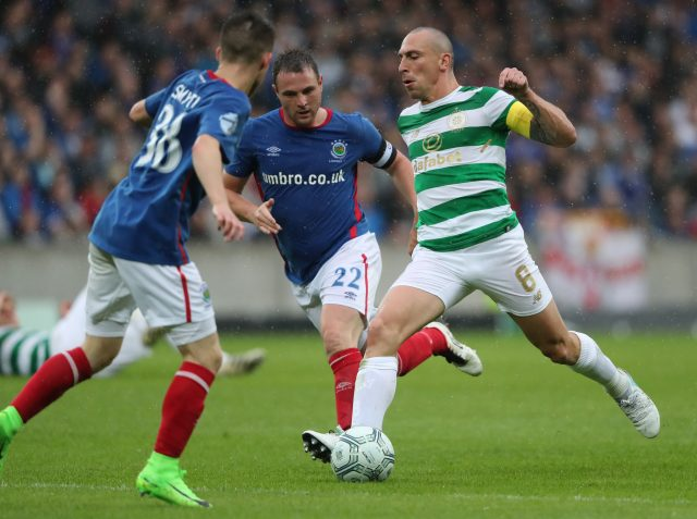 Celtic's Scott Brown (right) and Linfield's Jamie Mulgrew during the UEFA Champions League Qualifying, Second Round, First Leg match at Windsor Park, Belfast.