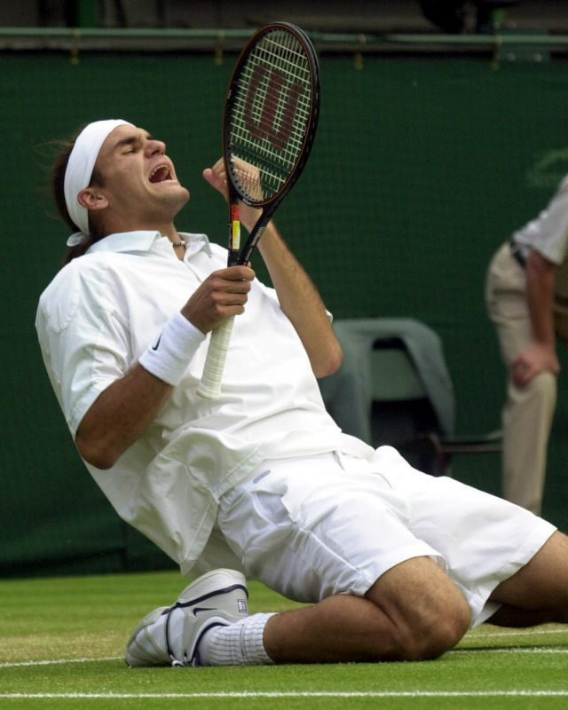Federer celebrates his first Wimbledon championship win over Pete Samprass in 2001