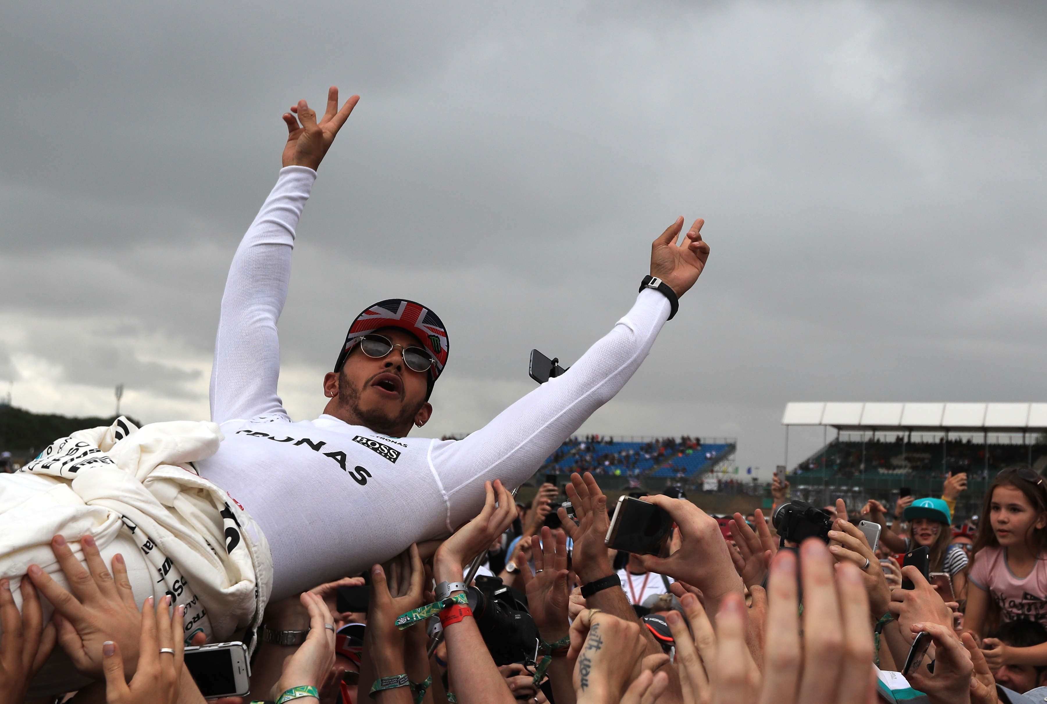 Mercedes' Lewis Hamilton celebrates by crowdsurfing with fans after winning the 2017 British Grand Prix at Silverstone Circuit, Towcester.