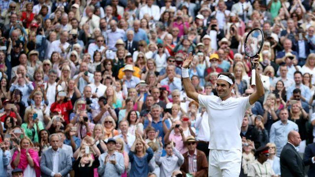 Roger Federer acknowledges the Wimbledon crowd after beating Thomas Berdych in the semi-finals