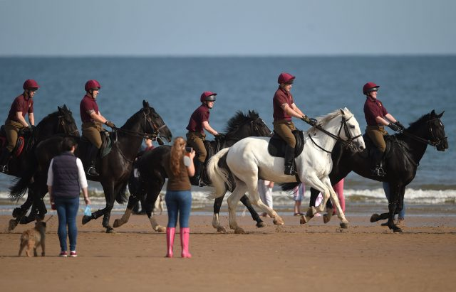 The beach exercises are part of the annual regimental training (Joe Giddens/PA)