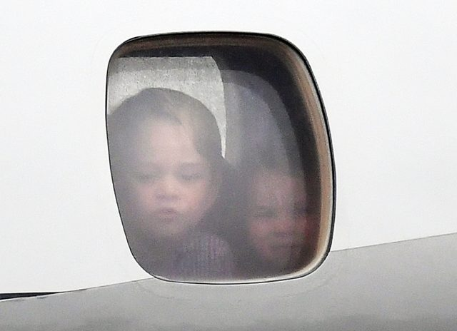 Prince George and Princess Charlotte look our the plane window