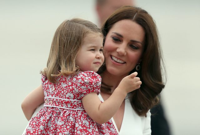 The Duchess of Cambridge, carrying Princess Charlotte