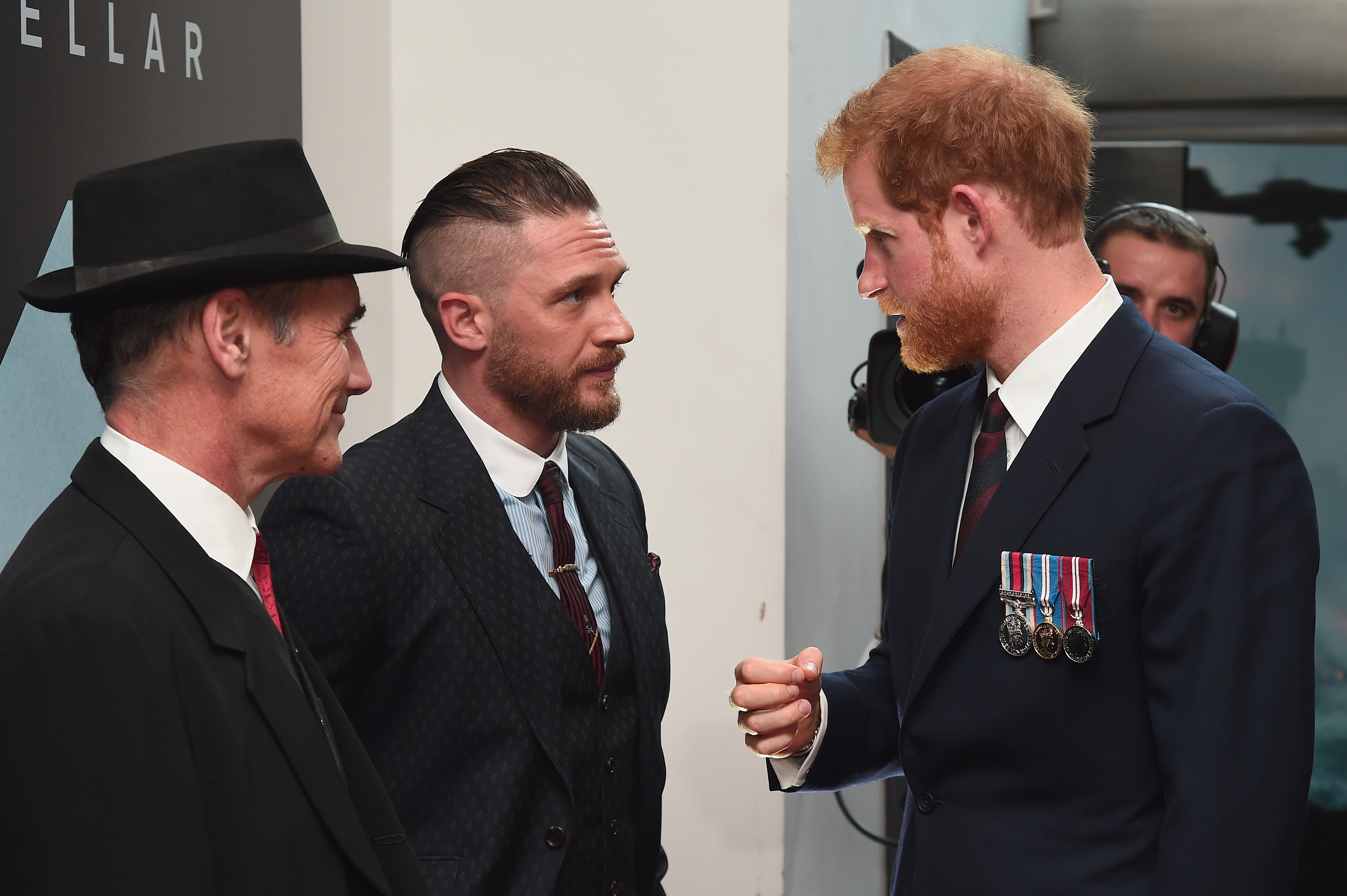 Prince Harry meets Sir Mark Rylance and Tom Hardy as he attends the Dunkirk premiere in London.