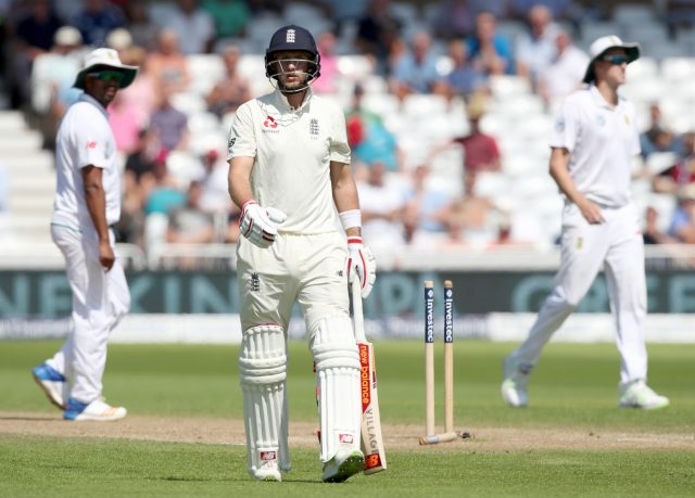 Joe Root walks off after being dismissed by South Africa's Chris Morris