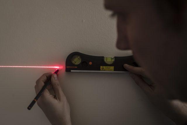 A man using a laser spirit