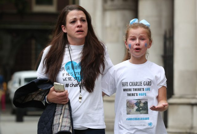 Charlie Gard supporters react outside the High Court