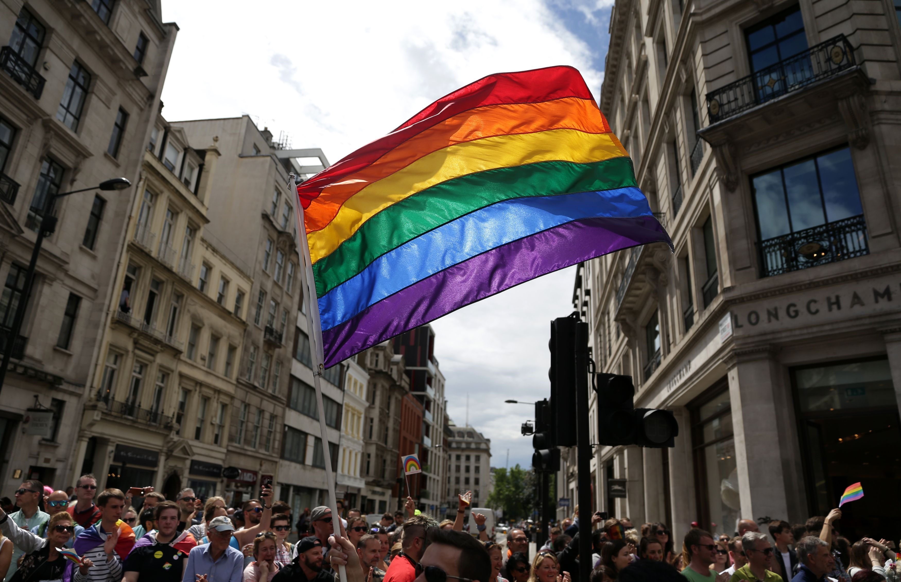 "File photo dated 25/06/16 of a rainbow flag held aloft during the Pride in London parade. Theresa May acknowledged that people may be sceptical about the Tory record on gay rights, but insisted that both she and the party had ""come a long way"" on the issue."