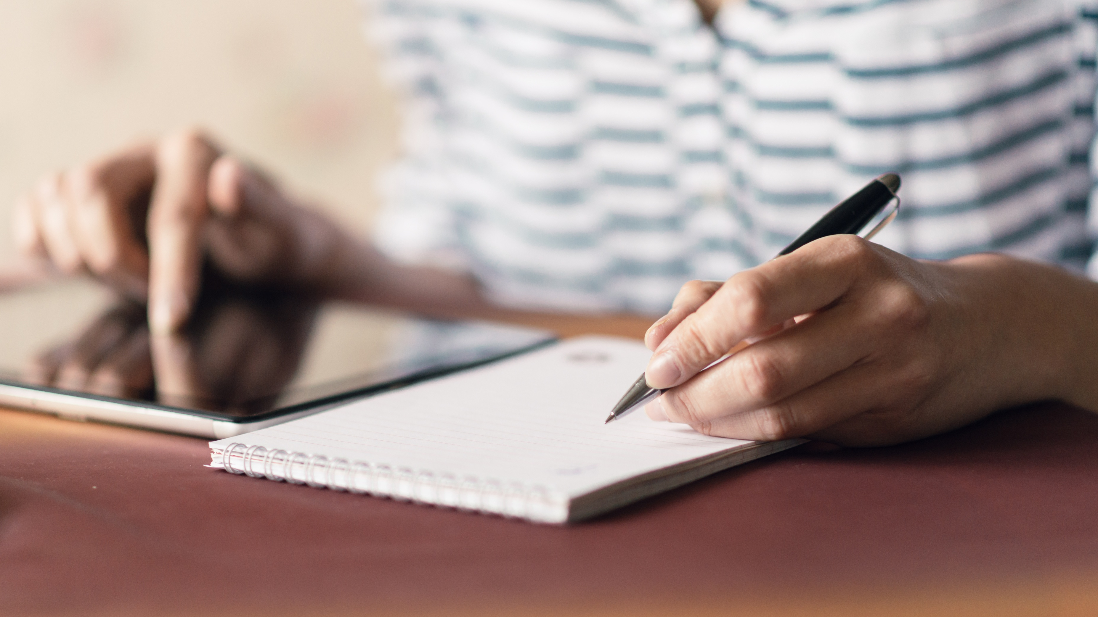 Generic photo of a woman writing a list in a notebook (ThinkStock/PA)