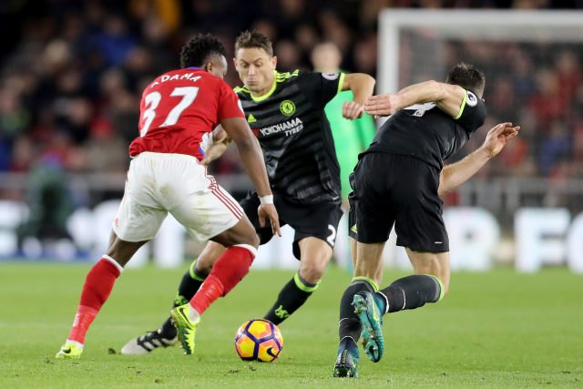 Chelsea's Nemanja Matic (centre) and Middlesbrough's Adama Traore (left) battle for the ball during the Premier League match at The Riverside Stadium, Middlesbrough.