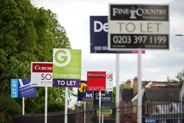 A variety of To Let, Let By and Sold estate agent signs outside houses in Richmond upon Thames, London.