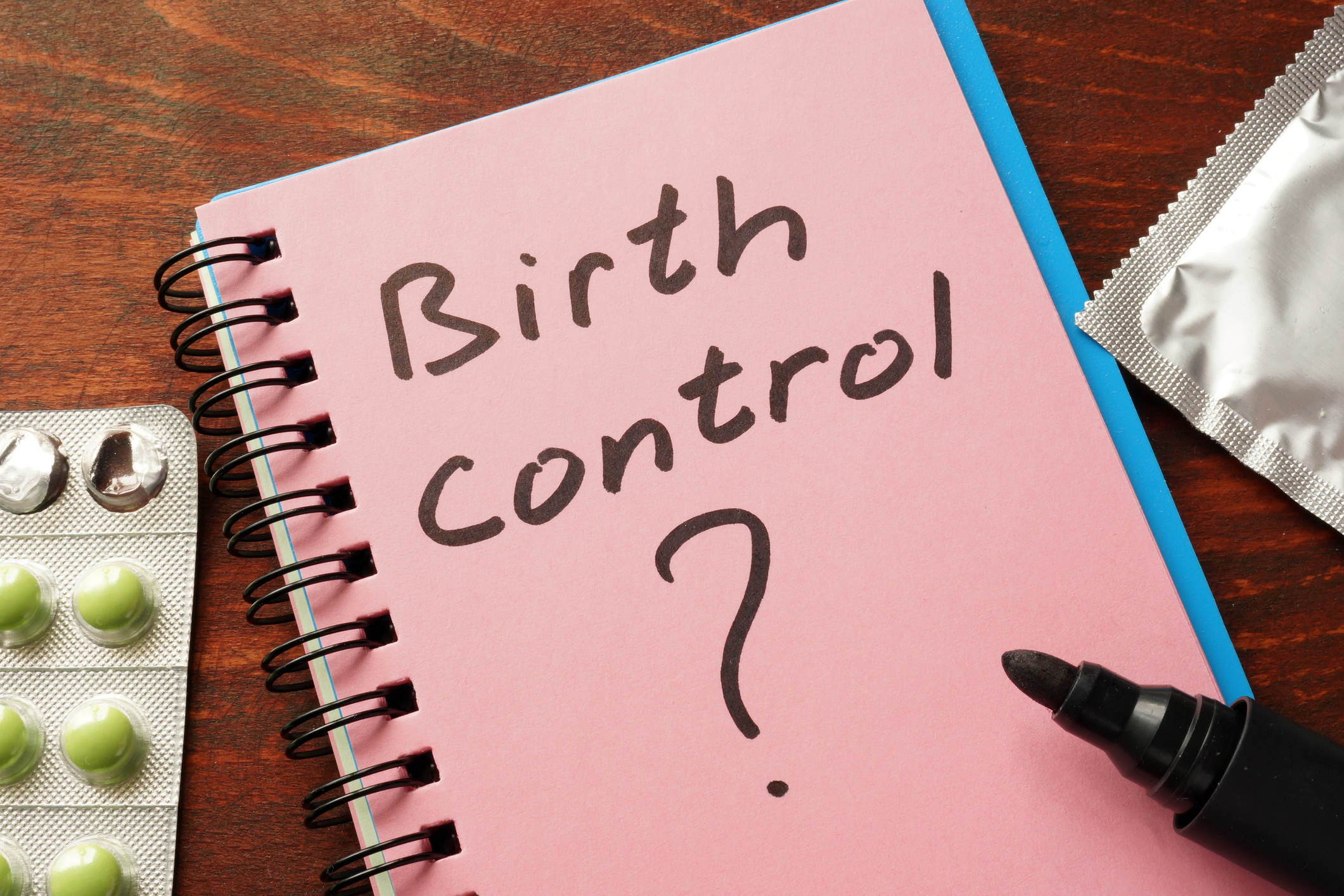 A book with birth control written on it