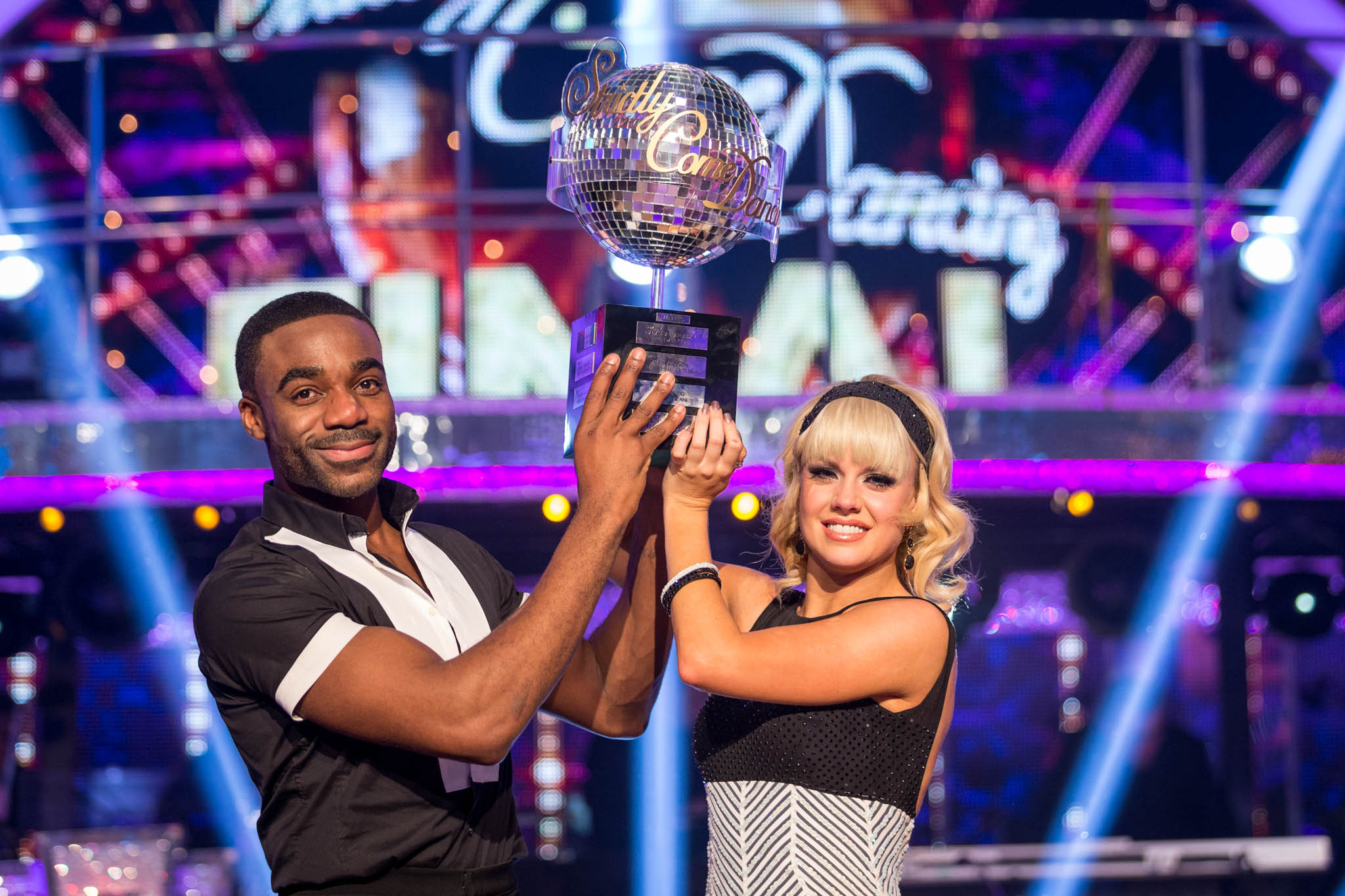 Joanne Clifton and Ore Oduba with the Strictly glitterball trophy (Guy Levy/BBC)