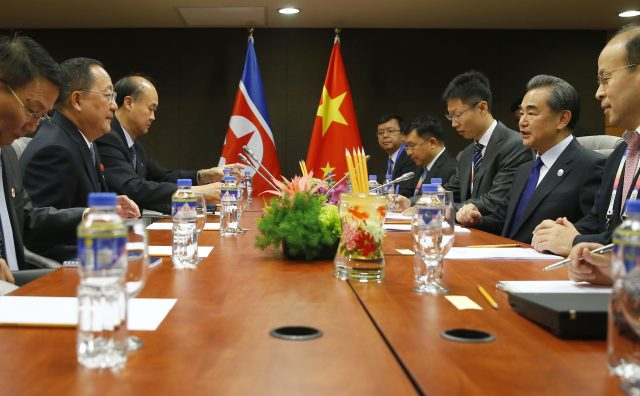North Korean and Chinese delegates talk in south Manila, Philippines. (Bullit Marquez/AP)
