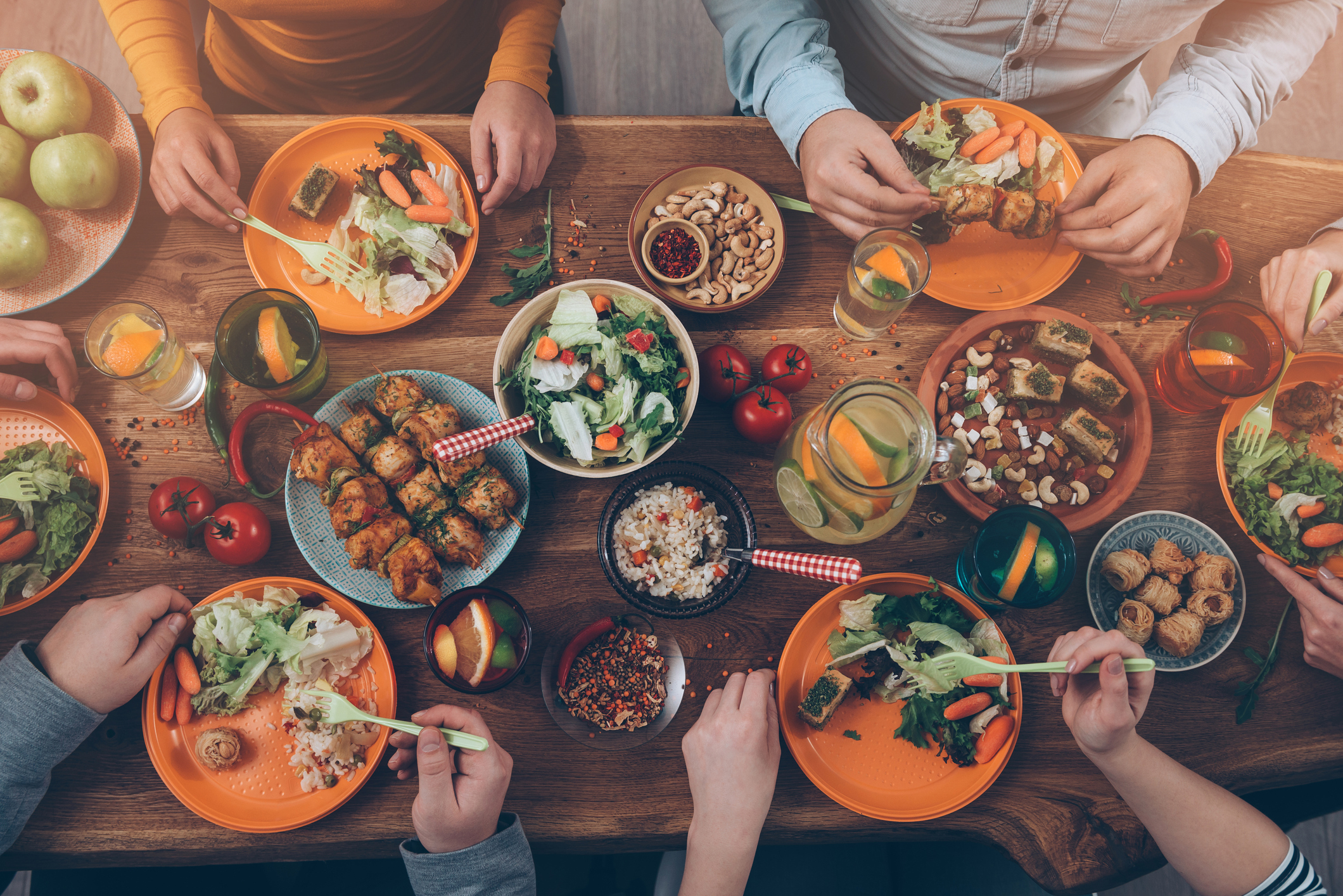 Overhead shot of people at a table full of food (Thinkstock/PA)