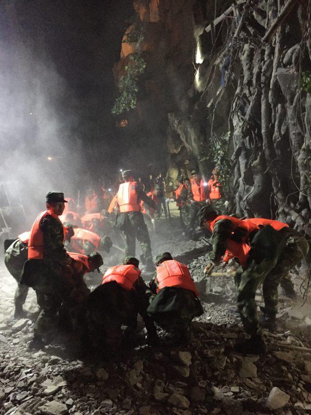 Rescuers work at a tourist site in Zhangzha in Sichuan province (Zheng Lei/Xinhua via AP)