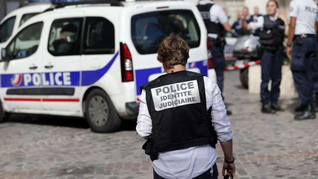 Police work on the scene where French soldiers were hit and injured by a vehicle in the western Paris suburb of Levallois-Perret (Kamil Zihnioglu/AP)