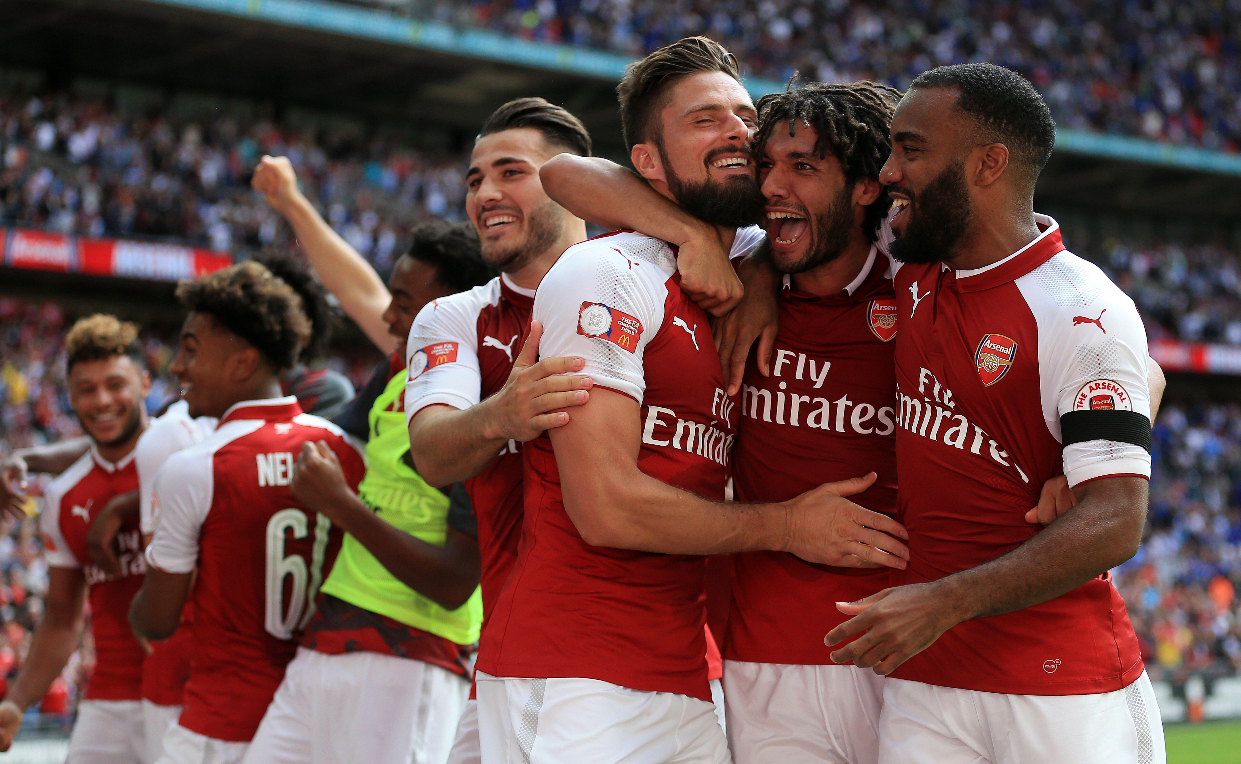 Arsenal's Olivier Giroud (centre) celebrates after scoring the winning penalty to win the Community Shield at Wembley