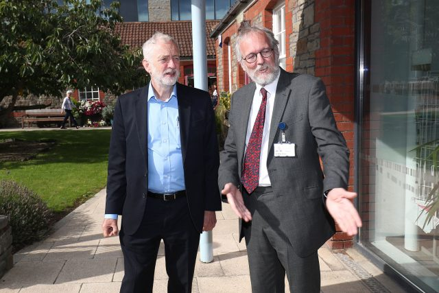 Jeremy Corbyn with Dr Mike Shere during a visit to the NGS Macmillan Wellbeing Centre in Westbury-on-Tyr, Bristol (Aaron Chown/PA)
