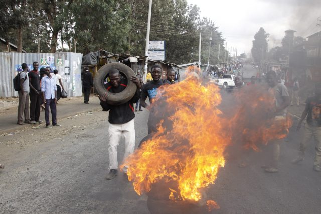 Supporters of Kenyan opposition leader and presidential candidate Raila Odinga demonstrate by blocking roads with burning tyres in the Kibera slum in Nairobi