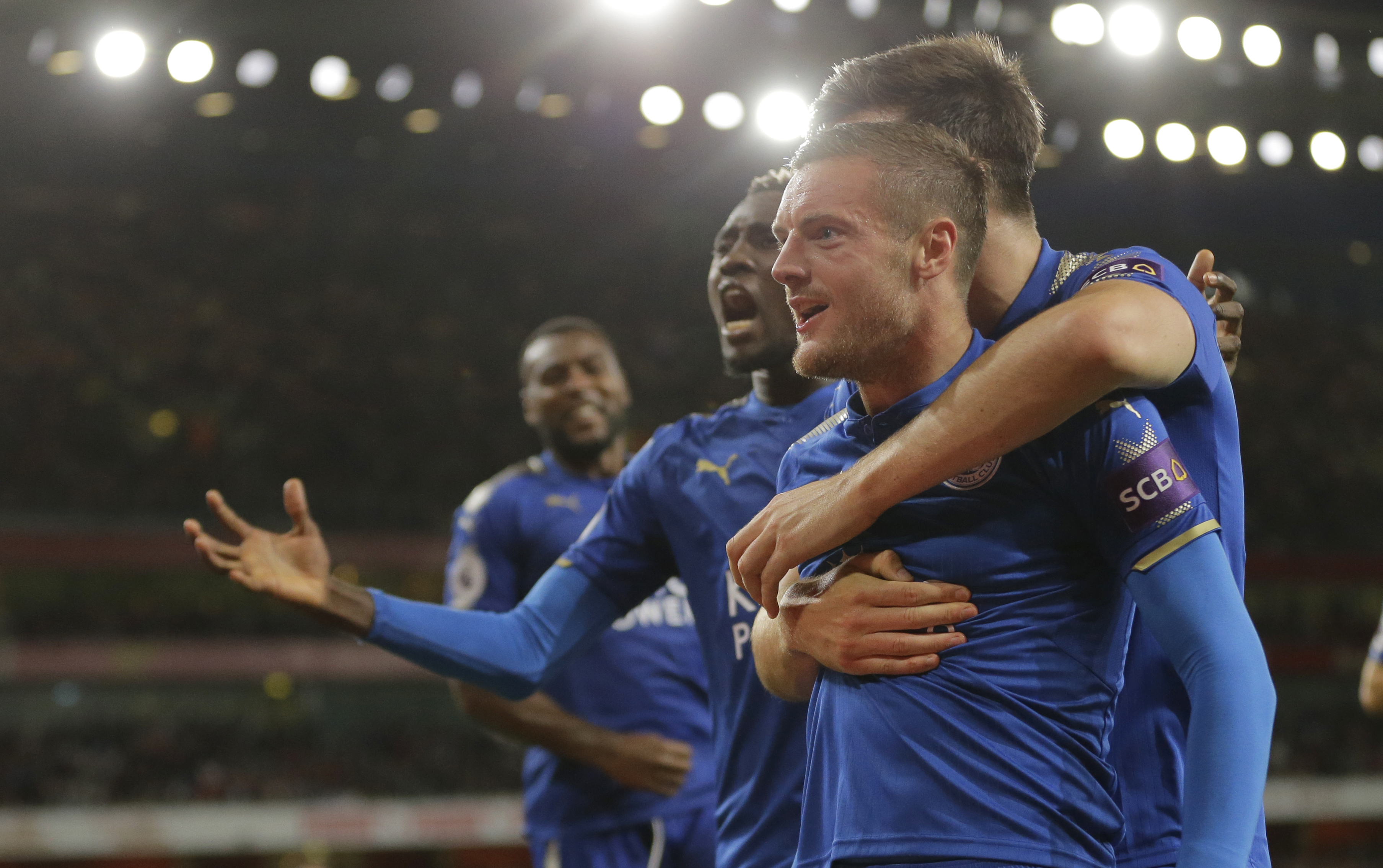 Vardy celebrates with teammates
