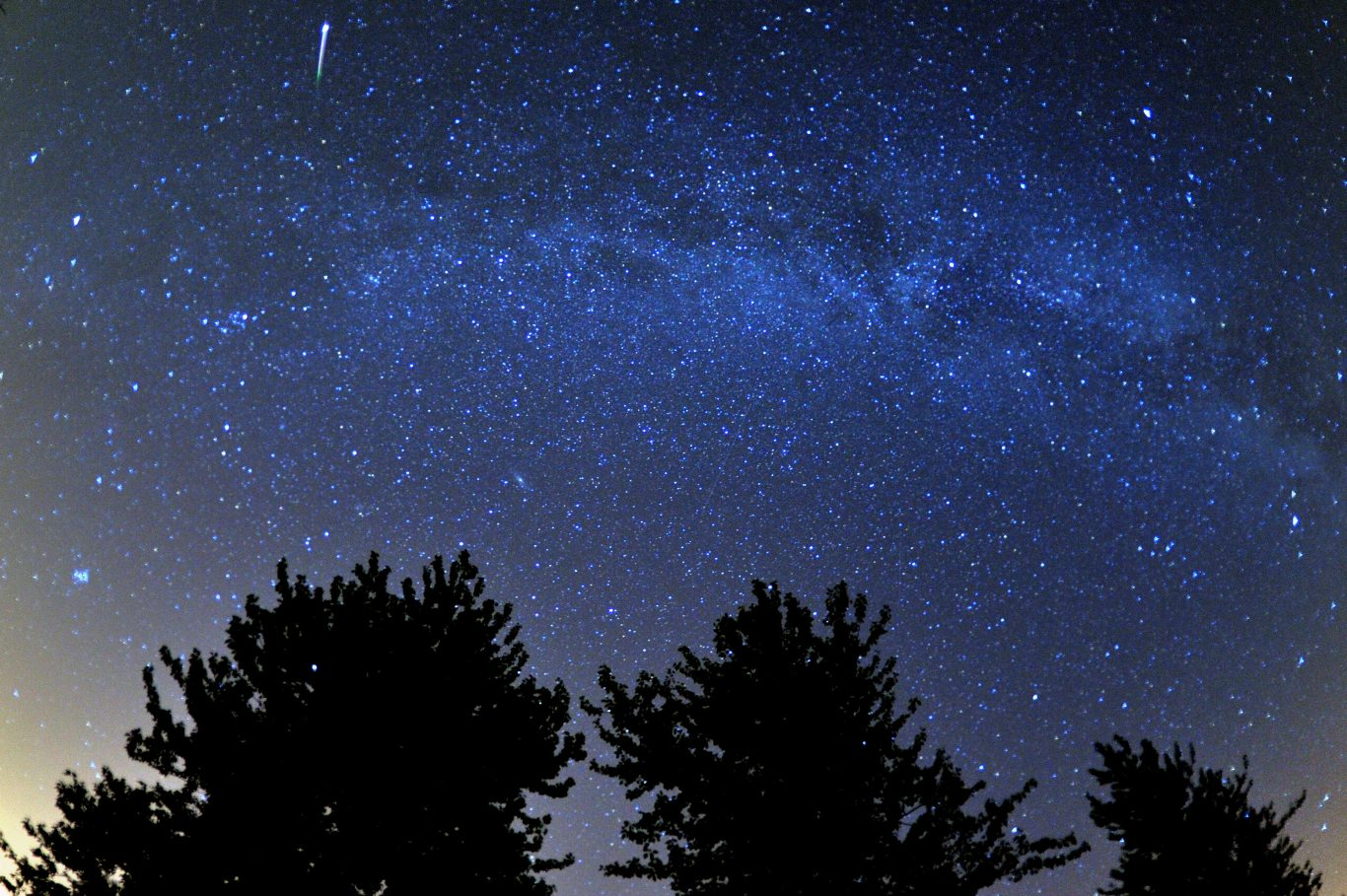 A meteor is seen during the Perseid meteor shower. (Tim Ireland/PA)