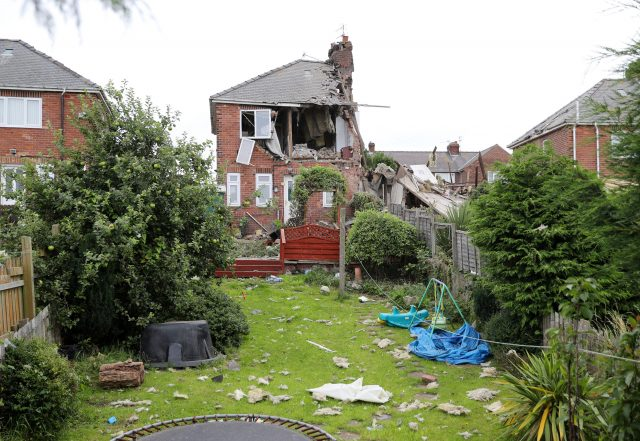 The neighbouring home was also badly damaged (Owen Humphreys/PA)