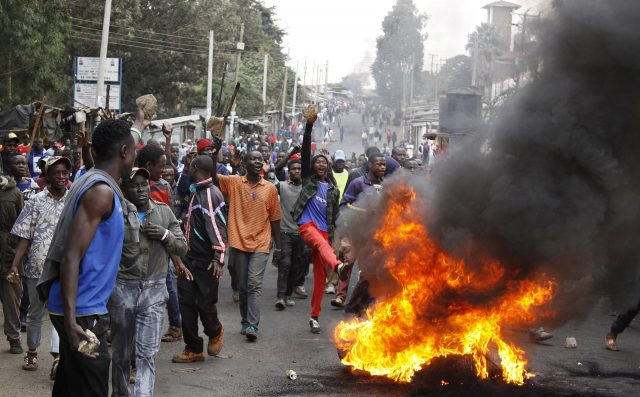 Fire barricades blocked a road at Kibera slum in Nairobi (Khalil Senosi)