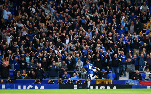 Everton's Wayne Rooney celebrates scoring his side's first goal during the Premier League match at Goodison Park.