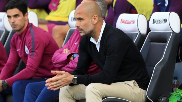 Manchester City boss Pep Guardiola watches his side beat Brighton 2-0 at the AMEX Stadium