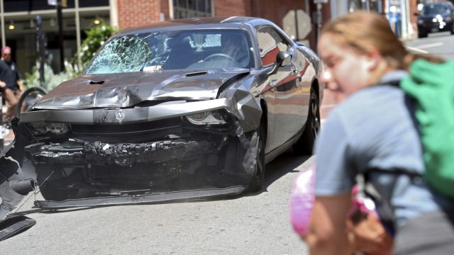 The damage to the car can be seen after hitting protesters