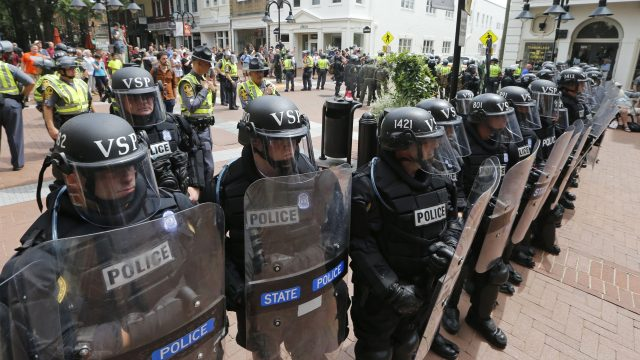 Virginia State Police cordon off an area around the site where a car ran into a group of protesters after a white nationalist rally in Charlottesville