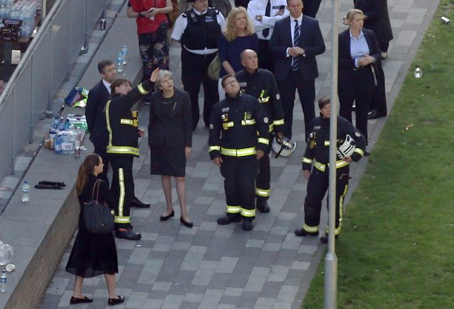 Theresa May visited the scene near Grenfell Tower in June