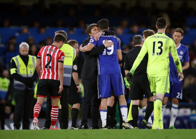 Conte and Costa embrace after a Premier League match in April (Nick Potts/PA)
