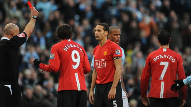 Referee Howard Webb shows Ronaldo a red card for two bookable offences against Manchester City