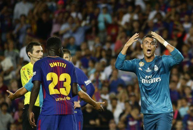 Cristiano Ronaldo, right, reacted to his red card by pushing referee Ricardo de Burgos Bengoetxea (Manu Fernandez/AP)