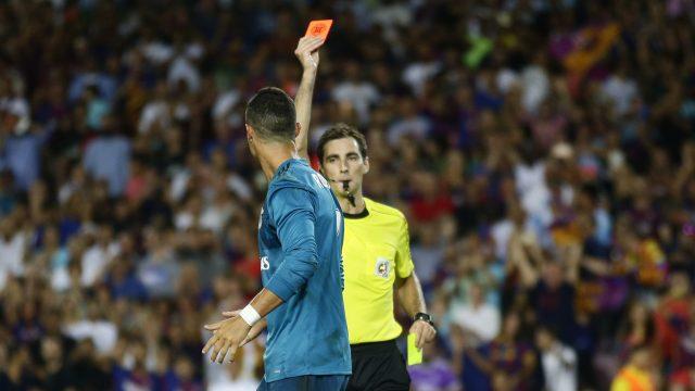 Ricardo de Burgos Bengoetxea shows Cristiano Ronaldo the red card