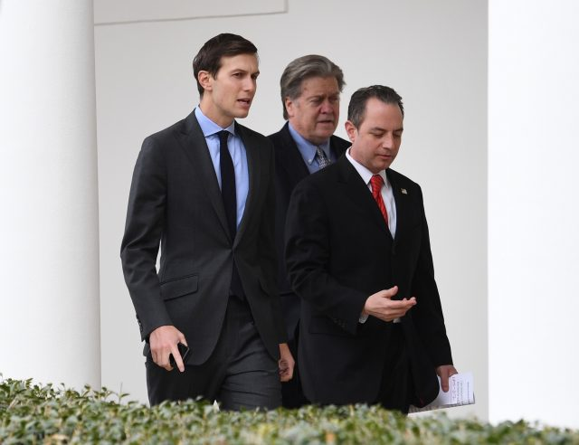Steve Bannon, centre, earlier this year with Donald Trump's son-in-law Jared Kushner, left