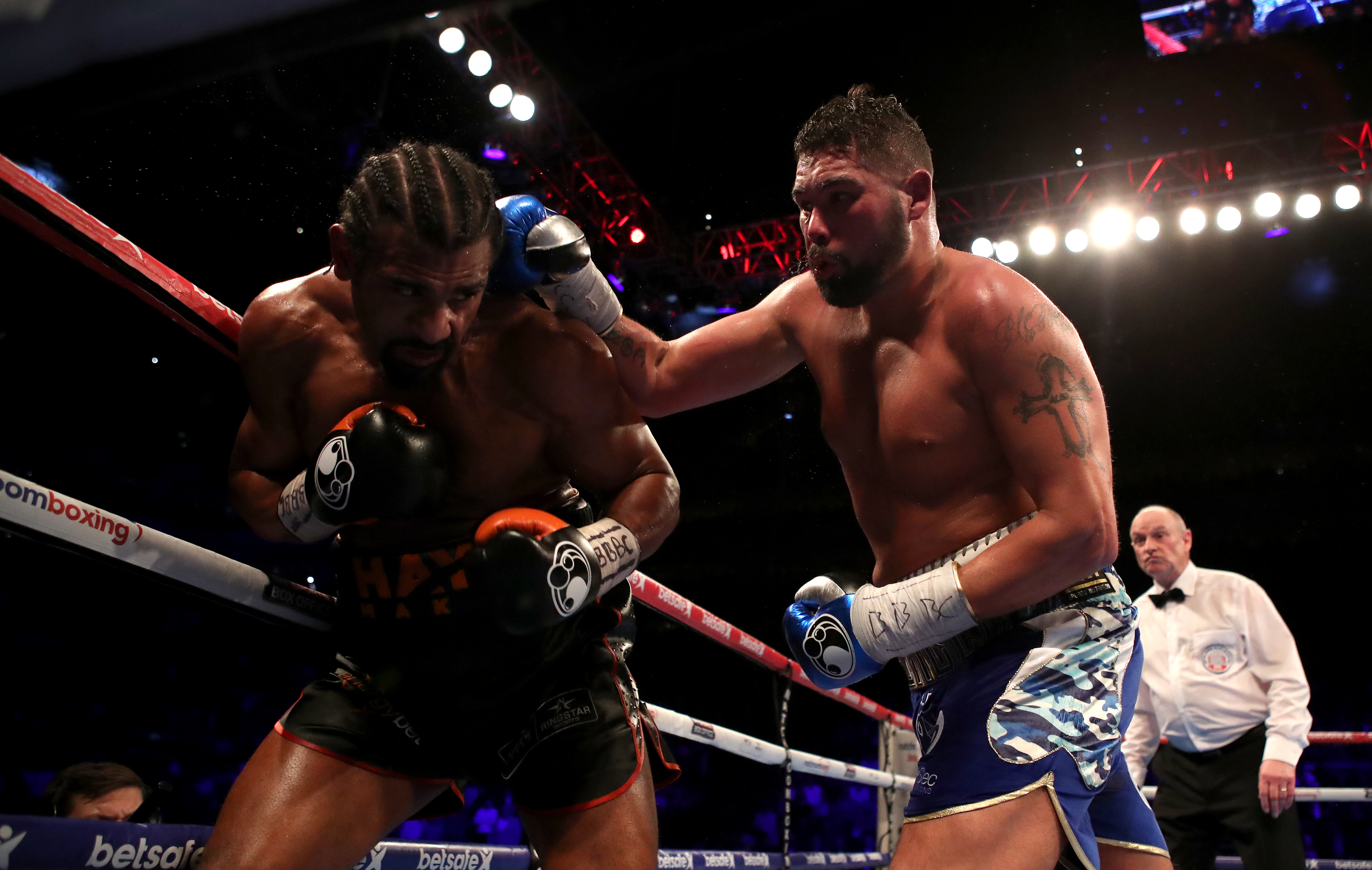 David Haye (left) takes on Tony Bellew during the heavyweight contest at The O2