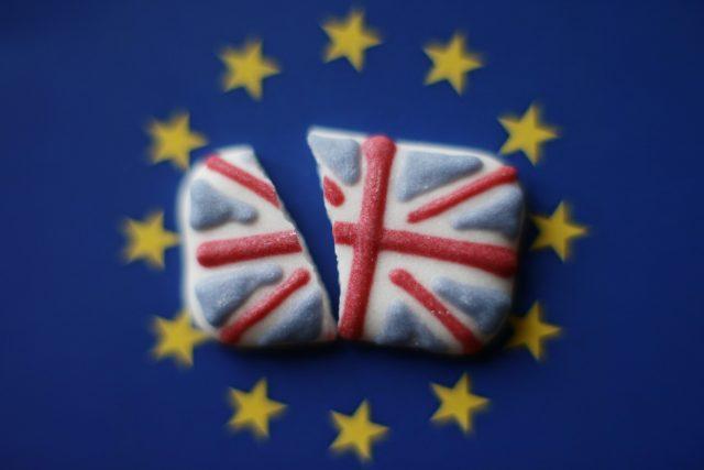 A broken Union flag on a backdrop of the EU flag