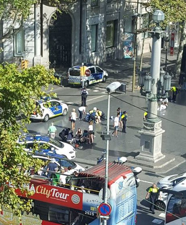 Emergency service workers at the scene in Las Ramblas