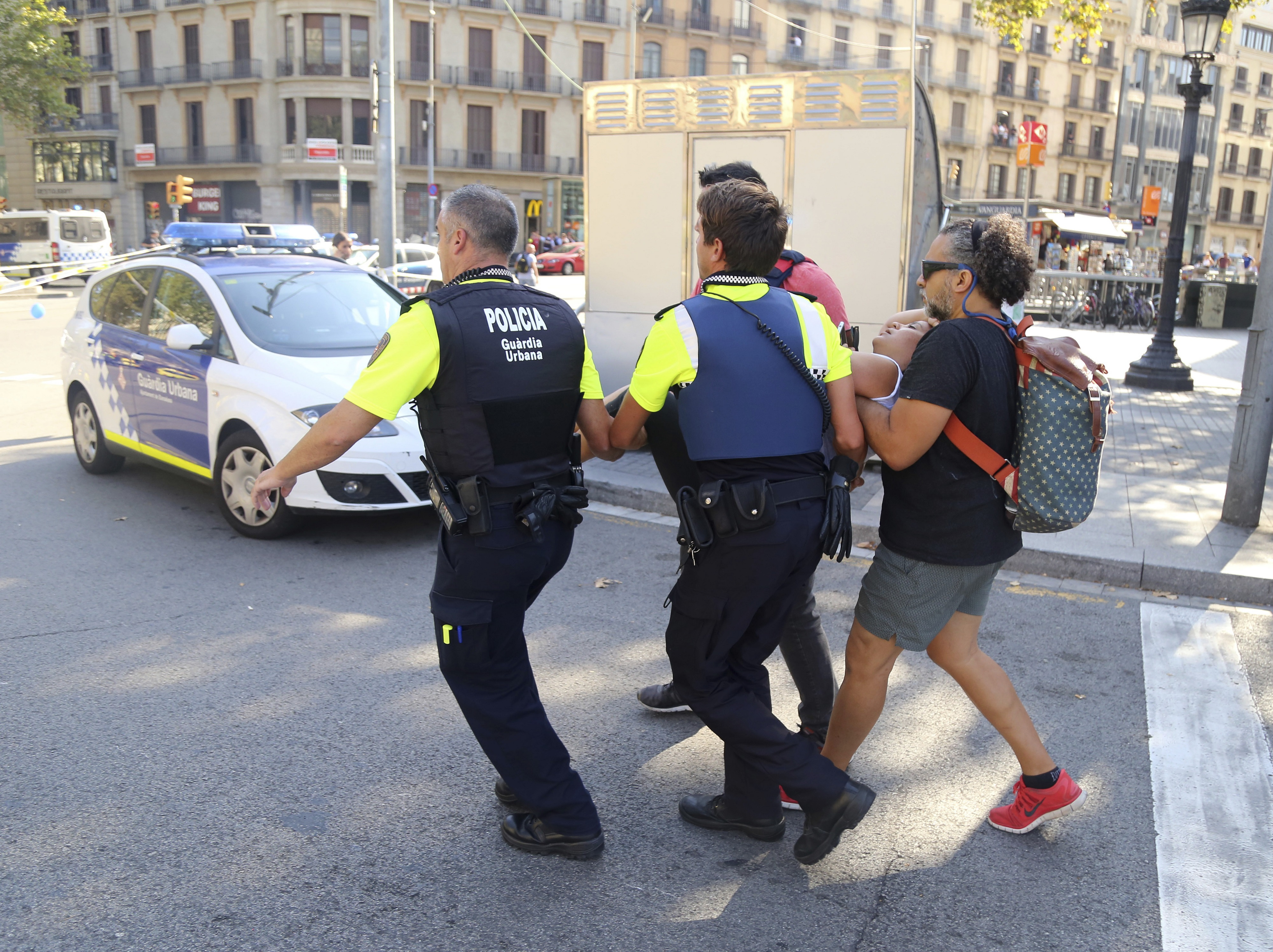 An injured person is carried away in Barcelona